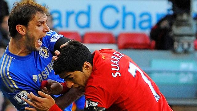 Luis Suárez bites Branislav Ivanovic