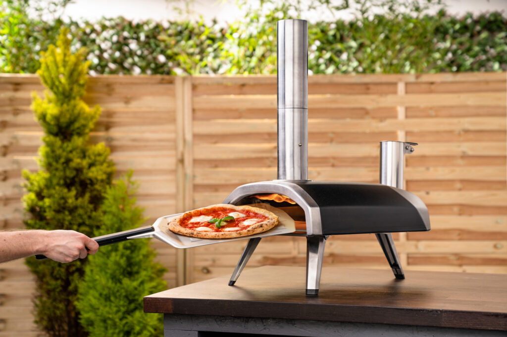 pizza cooked on oven oven