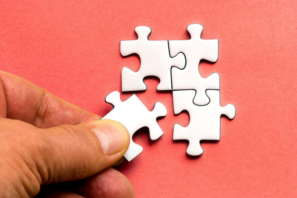 man doing a jigsaw